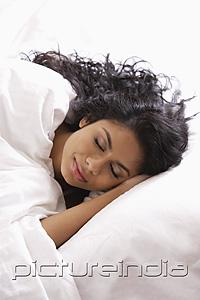 PictureIndia - Head shot of Indian woman sleeping in bed