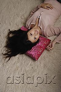 AsiaPix - Chinese woman laying on pink pillow