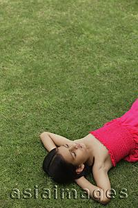 Asia Images Group - little girl in pink dress sleeping in park