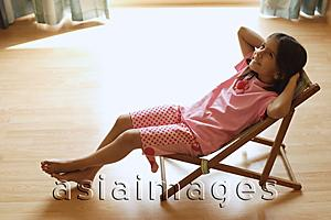 Asia Images Group - Little girl in chair