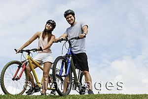 Asia Images Group - Couple on bicycles