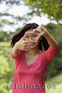 Asia Images Group - Woman making hand gesture