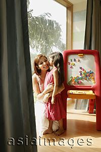 Asia Images Group - mother and daughter at easel
