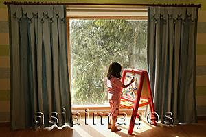 Asia Images Group - little girl at easel