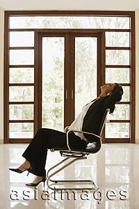 Asia Images Group - woman in empty office or home