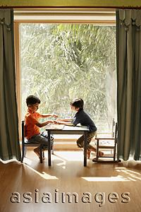 Asia Images Group - two little boys playing at table