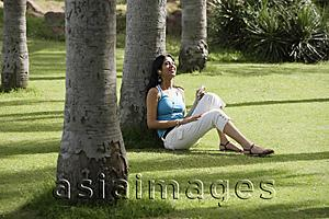 Asia Images Group - teen girl listening to music in park