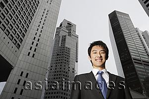Asia Images Group - Portrait of businessman among buildings