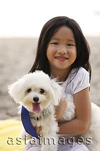 Asia Images Group - Young girl hugging dog.