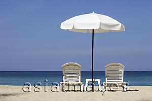 Asia Images Group - White umbrella and chairs on beach