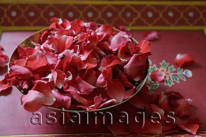 Asia Images Group - Red rose petals in bronze bowl
