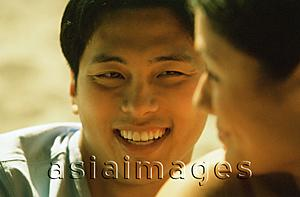 Asia Images Group - Profile of young woman smiling at young man