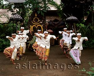 Asia Images Group - Indonesia, Bali, young boys in traditional costume dancing