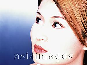 Asia Images Group - Young woman looking away, portrait