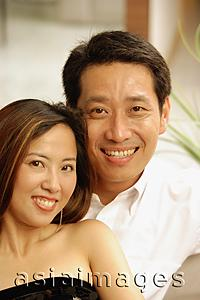 Asia Images Group - Couple looking at camera, portrait