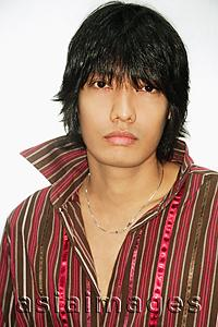 Asia Images Group - Young man looking at camera, portrait