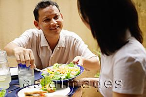 Asia Images Group - Husband serving wife salad