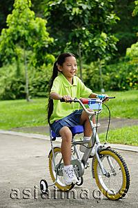 Asia Images Group - Young girl on bicycle