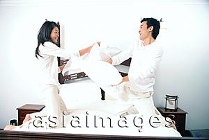 Asia Images Group - Couple pillow fighting