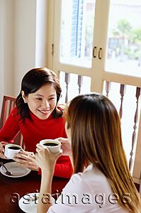 Asia Images Group - Women having coffee in cafe