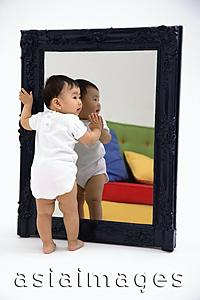 Asia Images Group - Baby boy standing against mirror
