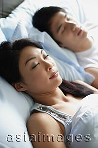 Asia Images Group - Couple side by side in bed, sleeping