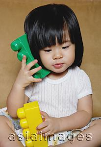 Asia Images Group - Young girl playing with toys