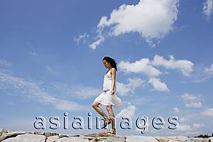 Asia Images Group - Woman walking on breakwater