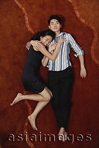 Asia Images Group - Couple lying on floor, high angle view