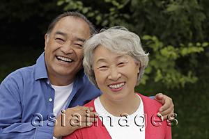 Asia Images Group - Older couple embracing outdoors