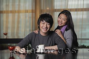 Asia Images Group - Young couple at cafe smiling