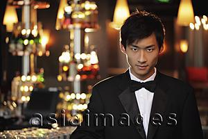 Asia Images Group - Young man wearing a tuxedo at night