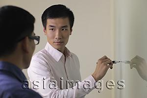 Asia Images Group - man writing on white board