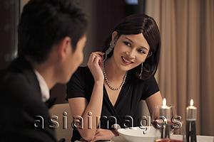 Asia Images Group - Young couple having a romantic dinner together