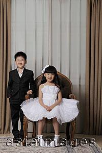 Asia Images Group - Young boy and girl dressed up in nice clothes smiling