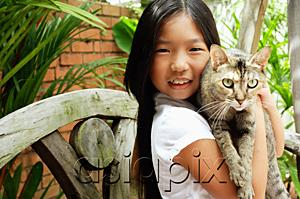 AsiaPix - Girl holding cat, looking at camera, smiling