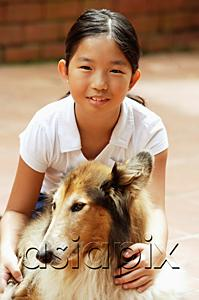 AsiaPix - Girl with dog, looking at camera