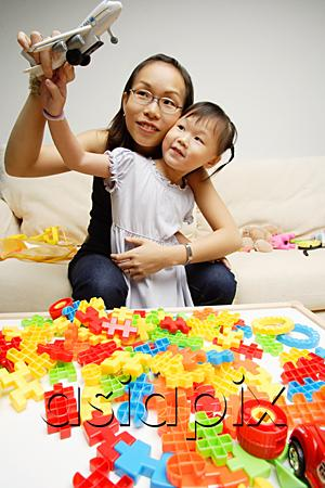 AsiaPix - Mother and daughter playing toy airplane