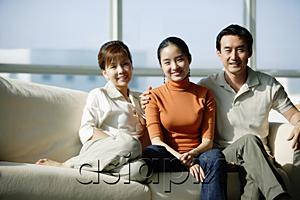 AsiaPix - Family with one daughter sitting on sofa