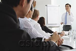 AsiaPix - Businessman presenting to other executives
