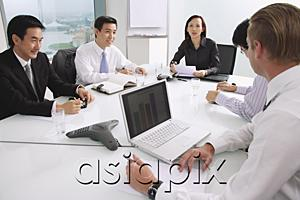 AsiaPix - Executives sitting around conference table, having a meeting