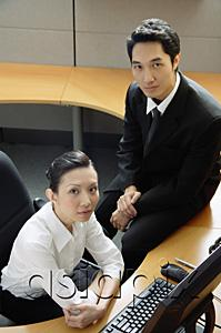 AsiaPix - Executives in office cubicle, looking at camera