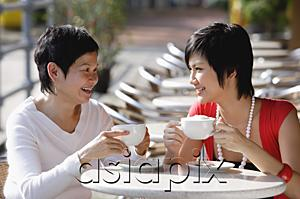 AsiaPix - Two women in cafe having a drink