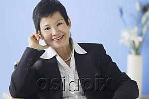 AsiaPix - Business woman smiling at camera