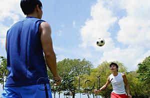 AsiaPix - Two men playing soccer