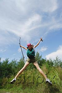 AsiaPix - Female hiker, jumping, arms outstretched