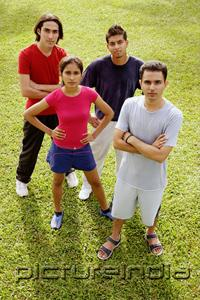 PictureIndia - Young adults standing, looking up at camera
