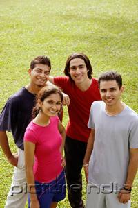 PictureIndia - Young adults standing together, looking at camera, smiling