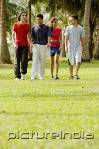 PictureIndia - Young adults walking in park