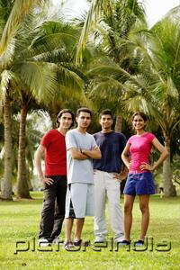 PictureIndia - Young adults standing in park, looking at camera